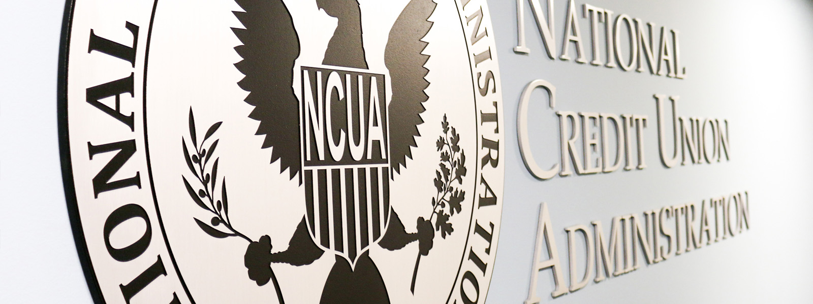 Image of the NCUA seal on a wall