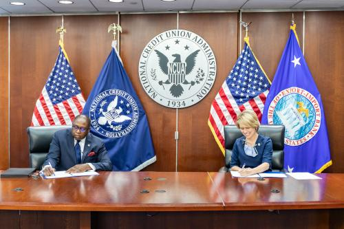 NCUA Chairman Rodney E. Hood and Export Import Bank President Kimberly A. Reed sign a memorandum of understanding. s MOU
