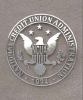The NCUA official seal on a stone background